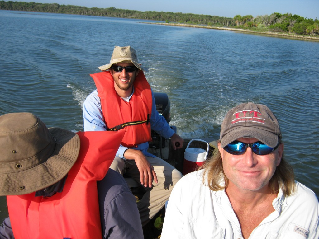 Lead authors Yoel Stuart and Todd Campbell boating between spoil islands in FL